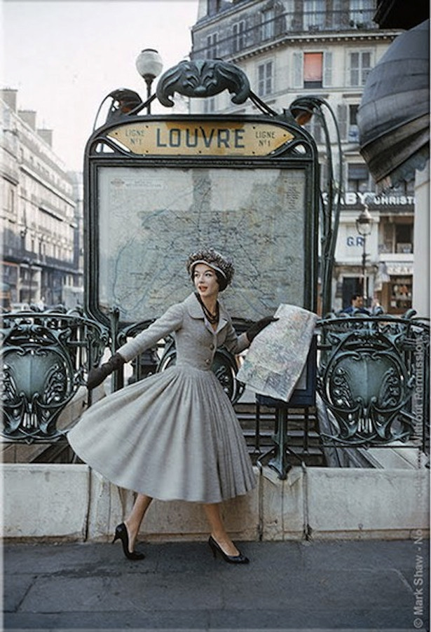 "Model at Louvre Metro. Paris, 1957. ""A Bright Young Look in Paris"". © 2010 Mark Shaw. Captured by Shaw for LIFE Magazine in 1957 is a model at Paris Louvre Metro Station wearing a gray Christian Dior dress. This image is an outtake from that assignment and did not appear in the LIFE article."