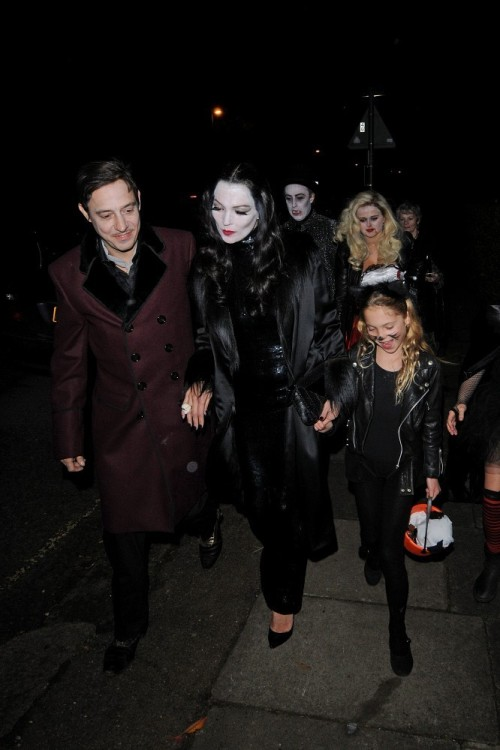 suicideblonde:  Kate Moss and her husband Jamie Hince dressed as Gomez and Morticia with Kate Moss' daughter Lila Grace going to a Halloween party, October 31st