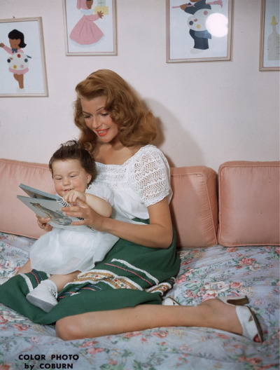 A beautiful color photograph of Rita enjoying some quiet time with her baby girl, Rebecca.