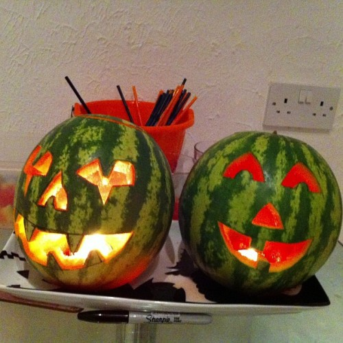 bluddyholly:  The stores ran out of pumpkins so we carved watermelons and drank watermelon-slushie-cocktails.  this is completely amazing. i can't believe how much it has blown my mind - like, the potential for year round jack-o-lanterns…..*KA-BOOM!* I'm trying to plan a big party for my 30th birthday (years away, but that's how I roll and if I will be able to obsess over every detail I'll be happy) and this is inspiring me to do a day-glo halloween in may. fucking aaahhhhh!!!