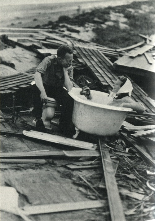 Kate tub lolling after the hurricane of September 1938. Source: Me: Stories of My Life (1991) by Katharine Hepburn, p. 208. The dude smiling and seated on an unattached commode is Red Hammond.