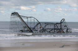 In New Jersey, Sandy destroyed several blocks of Atlantic City's world-famous boardwalk and wrecked several other boardwalks up and down the coast. A Seaside Heights roller coaster was left partially submerged in the ocean.  this is slightly terrifying and also really cool  its actually not cool at all. but ok.
