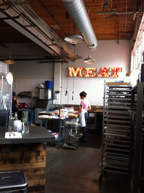 I never get tired of photographing the cool MEAT sign at Olympic Provisions.