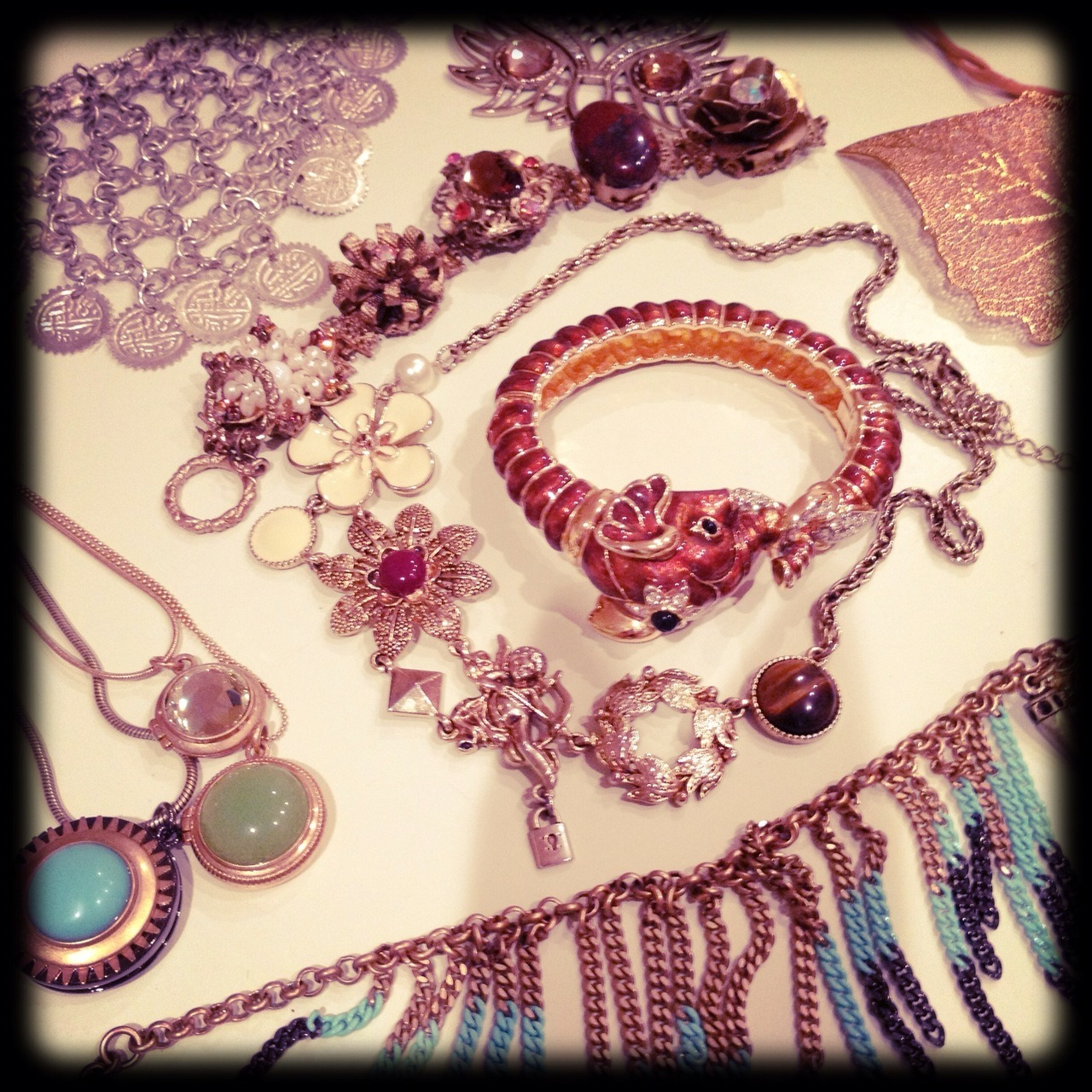 "Last night I decided to reorganize my jewelry.  I have tons of it, but rarely wear it because it is all stored in tiny boxes, which in turn are stored in baskets or larger boxes, so it's all hidden from view, and I end up forgetting about it and using the same four things over and over again. During my latest sleepless night, I had an epiphany and figured out a way to make my jewelry more accessible. During this process, I ended up finding pieces I didn't even know I had! It's almost like shopping in your own closet! (I know people say that, and it's true!) Some pieces I ended up having to throw away because they tarnished with time, some others are really old but I think I can find a way to make them work. Some others are just perfect and I can't wait to find the perfect outfit for them.  For now, I need to keep things in boxes, although I put them someplace that is far more reachable during my crazy ""I-cant-figure-out-what-to-wear"" mornings. One day, I will have a closet so big that all my jewelry will be nicely organized and clearly displayed. Here's hoping!"