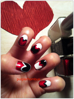 I was Queen of Hearts for Halloween this year. I had to do matching nails to complete the costume. :)