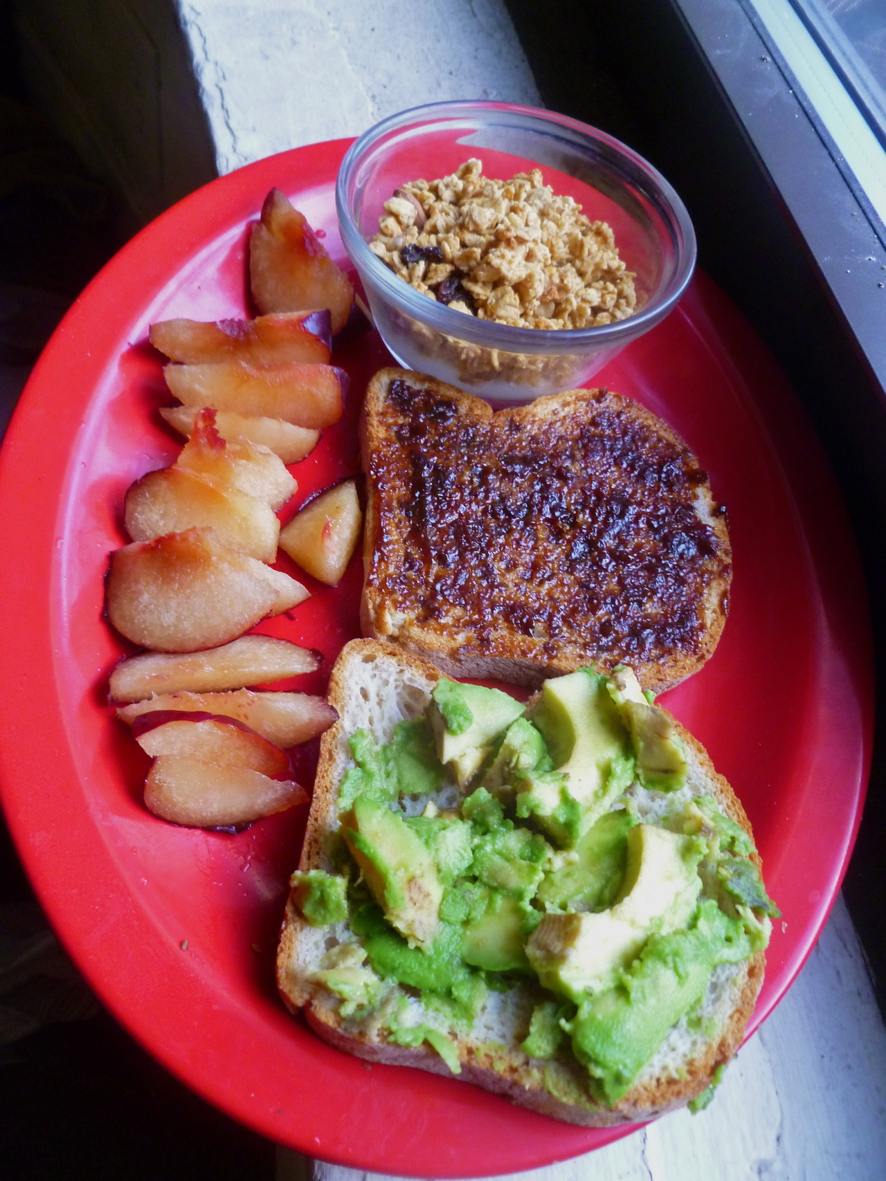 morning meals: avocado and fig butter spread across 2 slices of Udi's gluten free whole grain bread, a few spoonfuls of Trader Joe's vanilla flavoured Cultured Coconut Milk topped with almonds and country pumpkin spice granola and a sliced-up plum!