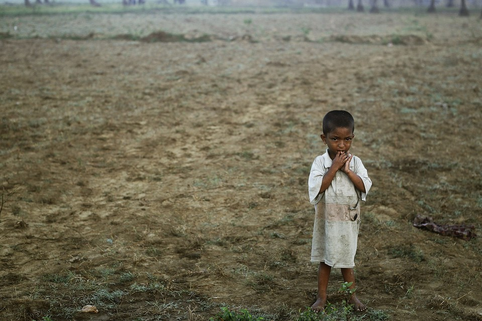 A boy displaced by recent violence stood near Owntaw refugee camp for Muslims outside Sittwe, Myanmar, Thursday. United Nations investigators called on Myanmar to halt deadly sectarian violence and warned it not to use the conflict as a pretext to remove minority Rohingya Muslims. Soe Zeya Tun/Reuters