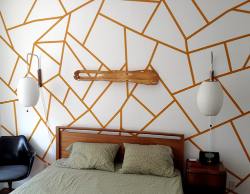 Geometric Painted Wall | Design*Sponge Sometimes I feel like I have two different sides to me when it comes to style. One side loves pastels, chintz, vintage furniture, florals and gold. The other side of me loves anything geometric, grey & muted, sleek danish design and bronze. Fortunately these two styles are veryeasy to combine! So when I saw this DIY I thought - OK I adore the geo pattern, but it needs more… pastels. So I'm thinking I tape up the design and fill it in with greys and pastels. Best of both worlds! Of course, if you're looking for something less permanent (or you're not allowed to paint walls) you could easily achieve this look with painters tape or even better - try coloured washi tape.