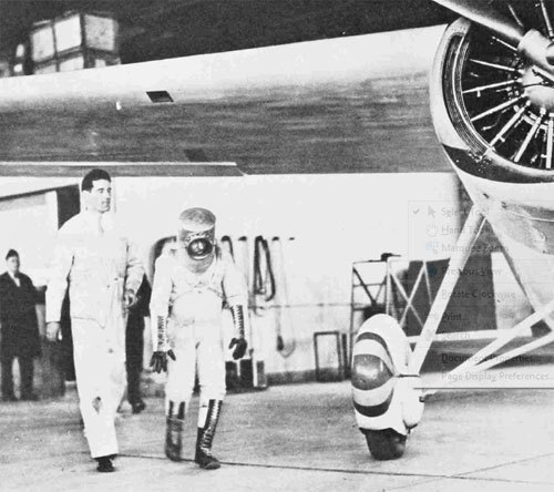 """Wiley Post walks slightly bent over toward the Winnie Mae, in preparation for a pressure-suit, airplane compatibility test. Note the criss-crossing support cords that help to keep the helmet from rising too high when the suit is inflated. The helmet faceplate is off. It was screwed on later when pressurization was necessary""   via a great download about Wiley Post, from the Smithsonian Annals of Flight"