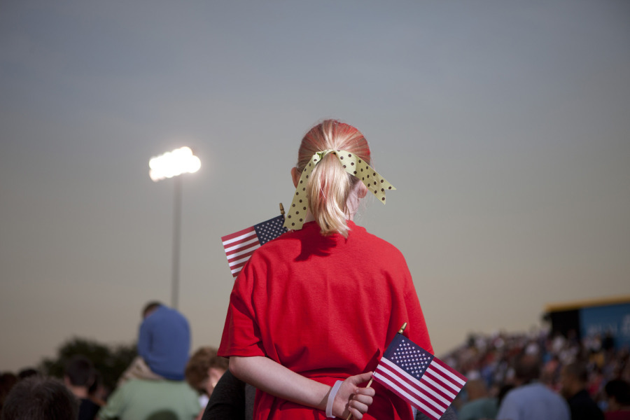 Oct. 27, 2012. A red-clad Romney supporter clutches two American flags during a rally at a football stadium in Land O' Lakes, Fla. (photo: Christopher Morris—VII for TIME) From the devastation of Hurricane Sandy and Eid al-Adha celebrations around the world to the final week of campaigning for the 2012 U.S. presidential election and a suspected smuggler's jeep perched atop the U.S.–Mexico border fence, TIME presents the best images of the week. See more photos here.