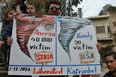0sb:  Another creative poster coming from Kafranbel:  —-Hurricane Sandy has caused the death of 90 victims in the USA. —-Aneesa (Bashar's mother) is the cause of 40,000 deaths in Syria.  May we see the end of this Assad superstorm soon!