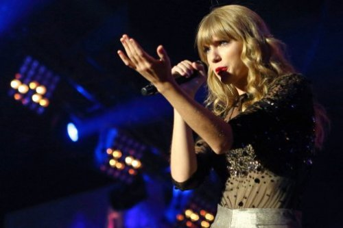"Taylor Swift, Badass:  The reason that people—in particular 20-something women—seem to take issue with Swift, it seems, is that they feel she merely whines about boys, which they then construe as being ""weak"" and ""anti-feminist,"" since she's a romantic and falls hard. (Hell, wasn't Adele's 21 all about a miserable break-up?) Plus, she dresses conservatively and, with her tousled blond tresses, lipstick, and squinty blue eyes, resembles a grown-up American Girls doll. Oh, and she deals mostly in country music—a genre that's much maligned by indie snobs. Unlike her female solo artist contemporaries—the Katy Perrys and Adeles of the world—Swift doesn't sing about kissing girls and doesn't chain-smoke or curse. She appears to be, on the surface, a paragon of chastity and virtue. But that doesn't mean she isn't a feminist. It's all really a matter of audience. Swift's target audience is 10- to 18-year-old girls. She's a hell of a good role model for that age group. I attended a recent Swift show at the Ed Sullivan Theater in Manhattan and, at her stellar live performance, chops aside, by the looks of things the audience was comprised almost entirely of young, wholesome girls—either in groups, or with a parent in tow. There's absolutely nothing wrong with that."