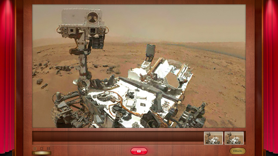Curiosity Snaps Its First Self-Portrait On Mars By Andrew Liszewski A few days ago Curiosity used its Mars Hand Lens Imager camera to snap its first self-portrait which will allow NASA mission engineers to inspect and document the state of the rover. [[MORE]] For the moment only a low-res version of the image is available, stitched together from a collection of thumbnail images. But once the high-res version is sent the engineers will be able to examine the amount of dust the rover has accumulated during its stay on the red planet, as well as monitor wheel wear since AAA isn't available off-earth just yet. The image was snapped at a spot known as Rocknest in the Gale Crater, and in front of the rover you can see the scrape marks where it scooped its first soil samples. But if you can't wait for NASA to post the larger version, you can always monitor the incoming RAW imagery from Curiosity yourself via its website. [NASA via Universe Today]