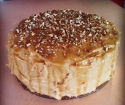 "TRIPLE BUTTERSCOTCH CAKE Do you have a sweet tooth? Well, you won't after you eat this cake, because all your teeth are gonna fall out. This masterpiece is made with two pounds of butter and more than 6 cups of sugar. It's got rum, it's got corn syrup, it's got whipping cream, it's got diabetes written all over it. And damn, diabetes, you're delicious. I don't have a stand mixer so I made this cake  completely by hand, (with the assistance of a sad hand mixer that I thought was going to die on me) and it was exhausting! I don't recommend it unless you're a badass. Although… I am developing a sweet baker's bicep. Also, I carried this cake around on the TTC for an hour. It's like 5 pounds! I need a nap, now. So, I made this cake for Bossman's 40th birthday. He's a butterscotch guy. He told me a story once about how his favourite flavour is butterscotch (some tart tried to sell him caramel ice cream instead of butterscotch. No dice, sweetheart. It's not the same!) and I stored it away in my baker's brain. You've got to know your audience: Dad is cheesecake, Mom is strawberry rhubarb and classic pies, Sarah is lemon, Macaroni Rascal is pecan pie and other corn syrup relatives, Abrubipityboo is chocolate and peanut butter, and of course Polish Prince is pumpkin. Bossman was so excited when he saw his cake that, when he hugged me, he nearly broke my ribs. And this cake is SO good. I almost skimped out on the pecans, but I'm really glad I didn't, they add an excellent dimension to the dense cake and super sweet butterscotch buttercream. I highly recommend that you make this sugarbomb showstopper for your next big soiree.  Man Rating: Marry me. CAKE1 1/4 cups butter, softened2 1/2 cups dark brown sugar, packed2 tablespoons canola oil4 large eggs2 tablespoons dark rum1 tablespoon vanilla extract4 cups flour1 teaspoon baking powder1 teaspoon baking soda1 1/2 teaspoons salt1 1/2 cups sour cream1 1/2 cups finely chopped pecansPreheat the oven to 325F degrees and grease two 9-inch cake pans with butter and flour.In a medium bowl, whisk together the flour, baking soda, baking powder, and salt. Set aside.In the bowl of an electric mixer fitted with the paddle attachment, beat the butter with the brown sugar until light and fluffy, about 3 minutes.Beat in the oil until well combined. Add the eggs, one at a time, beating well after each addition and stopping to scrape down the sides of the bowl as necessary. Beat in the rum and the vanilla.Add the flour mixture to the batter in two additions, alternating with the sour cream. Mix in the chopped pecans until combined. Divide the cake batter among the pans, filling about 2/3 full. Bake for 40-50 minutes, until it is golden brown and a cake tester inserted emerges clean. Transfer both the cake to a wire rack to cool completely.BUTTERSCOTCH BUTTERCREAM1 pound butter, softened 2 cups dark brown sugar, packed1 cup heavy cream1/2 teaspoon salt1 tablespoons dark rum2-2 1/2 cups confectioner's sugarMelt 8 tablespoons of the butter in a medium saucepan over medium heat until it turns deep golden brown and fragrant, about 6 minutes.Add the brown sugar, cream, and salt, stirring constantly until the sugar dissolves.  Bring the mixture to a boil, stirring constantly, and cook for 3 minutes longer.Transfer the mixture to the bowl of an electric mixer fitted with the paddle attachment, and beat it at high speed until the bowl feels cool to the touch, 8-10 minutes.Beat in the rum.With the mixer running on medium speed, add the remaining butter, one tablespoon at a time, beating until incorporated.  Continue to beat the mixture until it is smooth and creamy. Add enough confectioner's sugar to the mixture to achieve a thick and spreadable consistency.  Cover and refrigerate until ready to use.BUTTERSCOTCH SAUCE3/4 cup dark brown sugar6 tablespoons butter1/2 cup light corn syrup1/4 teaspoon salt1/2 cup heavy creamPlace the brown sugar, butter, corn syrup, and salt in a medium saucepan set over medium heat. Cook, stirring constantly, until the sugar dissolves.Bring the mixture to a boil and cook for 2 minutes, stirring frequently.Remove the mixture from the heat and mix in the cream. Return the saucepan to the heat and cook for 2 minutes more; let cool to lukewarm.ASSEMBLY Once everything is completely cooled, place a layer of frosting on one top of a cake, followed by a thin layer of the butterscotch sauce. Place the other cake layer on top, and spread a thin layer of frosting over the entire cake. Refrigerate for at least one hour (this will help ""glue"" crumbs down and serve as a nice, smooth canvas for you to apply the ""real"" frosting later.) Once set, finish frosting the cake. Drizzle with butterscotch sauce and garnish with extra pecans. Source: The Curvy Carrot"