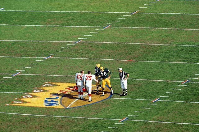 Chiefs captains Jon Gilliam and Jerry Mays shakes hands with Packers captains Bob Skoronski and Willie Davis before Super Bowl I at the Los Angeles Coliseum. The Packers beat the Chiefs 35-10. (Neil Leifer/SI) GALLERY: Neil Leifer's Historic NFL Photos