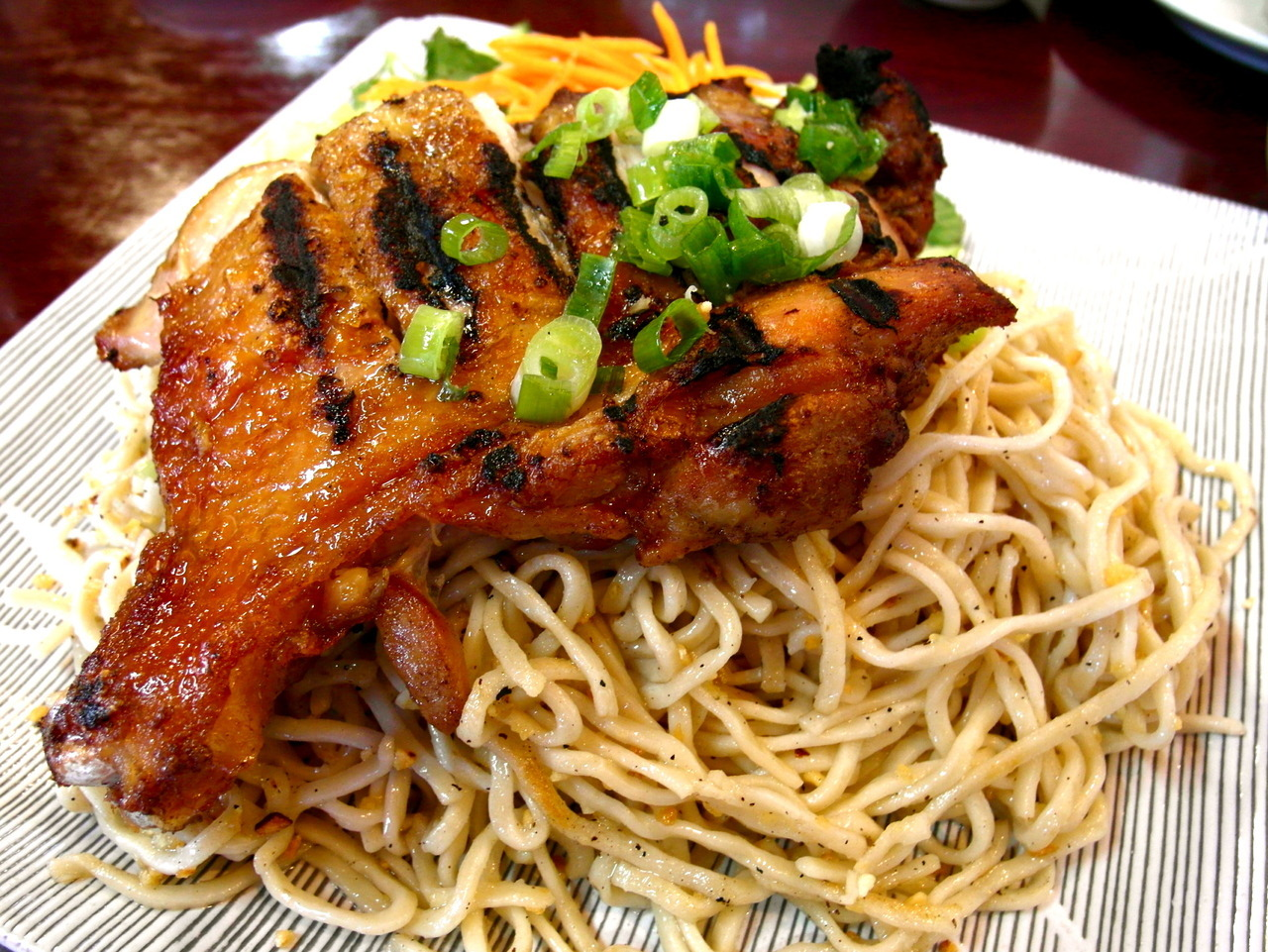 Grilled five-spice chicken over garlic noodles. Perfect pairing. A Vietnamese/Chinese treat. Awesome! Ben Tre Vietnamese Homestyle Cuisine 219 Grand Avenue South San Francisco CA 94080 Phone: 650.952.2243 www.bentrerestaurant.com