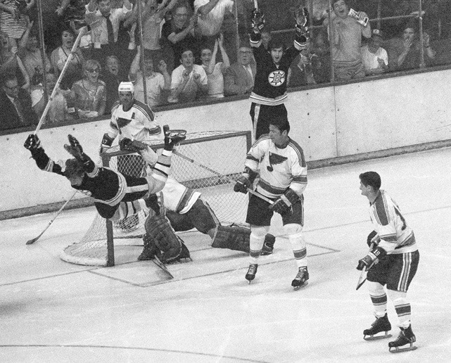 Bruins defenseman Bobby Orr flies through the air in this iconic photo after scoring the series-winning goal in the 1970 Stanley Cup Final against the St. Louis Blues. (AP) GALLERY: Iconic Photos of the Boston Bruins
