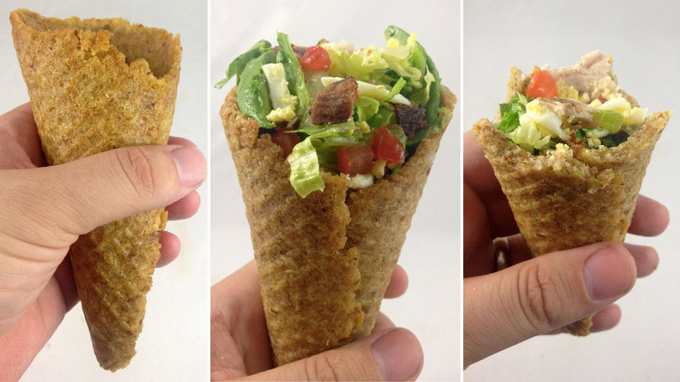 A Cobb Salad In a Crouton Cone Is a Fantastic Way To Eat Healthy By Andrew Liszewski The unrecognized geniuses over at DudeFoods.com have come up with an absolutely brilliant way to eat healthy. Or at least kind of healthy, depending on how you dress this Cobb salad served in a crouton cone. [[MORE]] It sounds pretty easy to make too. All you need to do is mix some crushed store-bought croutons with some oil, put it in a waffle cone maker for a minute (everyone has one of those, right?) and then bake it in an oven until it's crisp. Then you just need to fill it with a healthy salad and you'll feel guilt-free eating like ten of these in one sitting. [DudeFoods via Foodbeast]