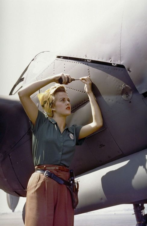 collective-history:  Female Lockheed employee working on a P-38 Lightning, Burbank, California, 1944