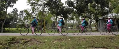"""Info Ladies"" Bring Internet to Remote Villages on Bicycle Part entrepreneur, part public service provider, Info Ladies are young women—usually undergraduates from middle-class rural families—who are recruited by local development group D.Net, trained for three months to use a computer, the Internet, a printer, and a camera, and then helped to secure loans to purchase equipment and bikes. They then take their services to rural Indian villages and charge for their services. 200 takas, the equivalent of $2.40, buys an hour of Skype time, for example. via AP:  In the neighboring village of Saghata, an Info Lady is 16-year-old Tamanna Islam Dipa's connection to social media. ""I don't have any computer, but when the Info Lady comes I use her laptop to chat with my Facebook friends,"" she said. ""We exchange our class notes and sometimes discuss social issues, such as bad effects of child marriage, dowry and sexual abuse of girls."" The Info Ladies also provide a slew of social services — some for a fee and others for free. They sit with teenage girls where they talk about primary health care and taboo subjects like menstrual hygiene, contraception and HIV. They help villagers seeking government services write complaints to authorities under the country's newly-enacted Right to Information Act. They talk to farmers about the correct use of fertilizer and insecticides. For 10 takas (12 cents) they help students fill college application forms online. They're even trained to test blood pressure and blood sugar levels.  Read more from the AP. Image: via AP"