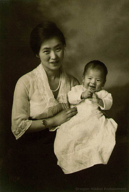 Portrait of Seki Hiromura, the mother of the donor of this photo, and one of her sons. Seki and her husband Kikuo raised their five boys in Portland, Oregon. Circa 1925.