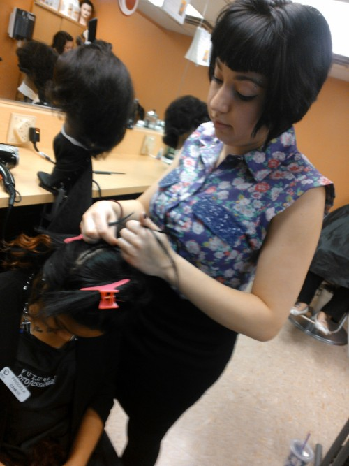 Here's a picture of me doing my first weave :D I'm terribly unattractive here.
