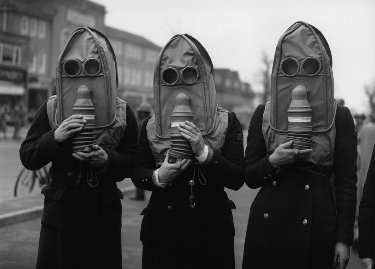 Air raid wardens demo a trio of spooky elephantine gas masks, designed for the elderly, during a simulated gas attack in 1941 London By Robert T. Gonzalez