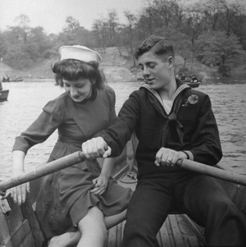 distraction:   A sailor and his date enjoying a day in Central Park while he is on shore leave, 1943.