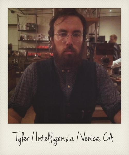 Tyler has been featured once before on Stuff Baristas Wear, but his sweet glasses deserved another feature. He picked them up at a vintage eyewear shop in Pasadena called Old Focals. He guesses they're from the 50's and are made by American Optical. Layne (a previously featured Intelligensia barista) found a cool vintage dress in Pasadena. So, it seems that might be a good place to look for vintage goods. The technology behind these glasses is called Ful-Vue was a major development that is still used in modern glasses. Read more about it here, if you're curious.