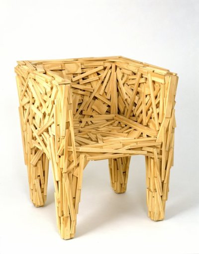 "The ""favela chair,"" designed by brothers Fernando and Humberto Campana (mentioned previously here), was inspired by the architecture of shanty towns, a.k.a. favelas, in the Campanas' native Brazil. Each chair is hand-glued and nailed together from scrap wood, making each chair unique.  Photo via SFMOMA, which is one of several museums with a favela chair in its permanent collection.  Spotted in the last slide of this post from The New York Times design blog. (In the NYT piece, check out the LOT-EK lamp made from a detergent bottle!)"