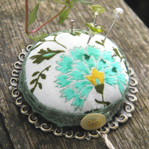 look, it is a brooch, AND a pincushion!  the sea urchins picked this! click to see!