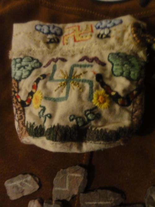 Rune bag I made for my husband. I will soon be making more similar and will be making them available for sale. I will post photos when they are ready to be purchased. Canvas material with embroidery and button or draw string closure.