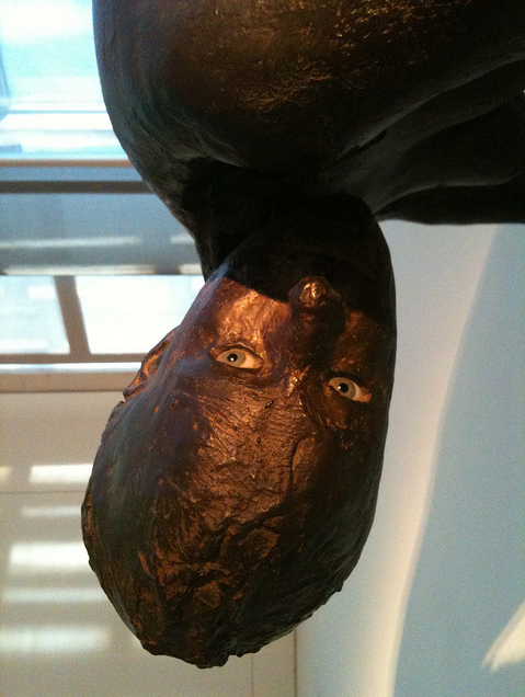 "minorfallandthemajorlift:  Kiki Smith - Lilith, 1994 - Bronze, silicon, and glass. ""In medieval Jewish lore, Lilith was Adam's first wife.  When she demanded to be Adam's equal, she was evicted from the Garden of Eden.  Lilith flew away to the demon world, replaced by the more submissive Eve.  Smith catches us off guard with Lilith's pose and placement.  Most sculptures receive our gaze passively, but Lilith stares back with piercing brown eyes, ready to pounce."""