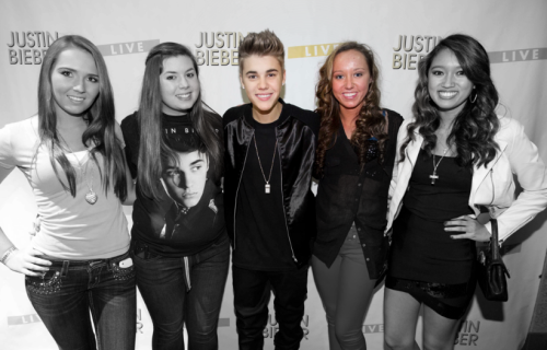 "mybieberexperience:  Saturday, October 20th, 2012. My friend Mary, my Dad, and I (Courteney) all drove down to Milwaukee, Wisconsin, for the concert that would take place on Sunday, the following day. After we arrived at our hotel and got situated, there wasn't much to do so I pulled out my laptop. At that moment I remembered that Mary and I had entered a contest through the BieberFever fan club only a few days prior, and that the winners were supposed to receive an e-mail within 24 hours before the concert. I quickly opened my inbox and froze. In my inbox sat a reply e-mail from the BieberFever fan club. My stomach dropped. I clicked on the e-mail and it read: ""Congratulations, Courteney! You're officially invited to attend the photo meet and greet TOMORROW NIGHT October 21st in Milwaukee!"" I immediately went hysterical. Barely able to talk, with all the breath I had left, I screamed to Mary. ""Mary! Mary! Mary! We won! We won!"" ""What?!?!"" She panicked. She quickly darted over to the computer and read the e-mail. We both went into complete shock, dropped to the ground, and started bawling our eyes out. We couldn't believe what we were reading. It felt like I was literally in a dream. After supporting Justin for almost four years, my dream was finally going to come true. After seeing pictures upon pictures and videos upon videos of fans meeting Justin, tomorrow night, October 21st, 2012, was finally going to be my opportunity to meet my idol. Sunday, October 21st, 2012. Today was the day that my life was going to change forever. I set my alarm for 5:30am so we could arrive to the venue early and see if anything would happen. Apparently we slept through the alarm, because I woke up and checked the time, and it was 9:30am. Mary and I jumped out of bed and started getting ready. After we were all ready to go, we went to the BMO Bradley Center, the venue where Justin would be playing. There was already a bunch of girls lined up at the gates waiting for something exciting to happen. After standing there in the cold for a few minutes, across the gate, I saw a hand wave. It was Laney (@BlazingBiebzz) and Elyse (@Fever4Biebs), the girls I had purchased tickets for to see the show that night. I ran over to them and we greeted each other. After finding out that they'd been there for quite some time already and that Justin had arrived earlier, across the distance I heard someone yell ""Courteney!"" I looked over and noticed that it was Brooke, (@WISimpsonizer). I waved back and after a while Mary and I went back to the other side of the gates and greeted them. We were both extremely excited because she too was meeting Justin that night with another owner on her Twitter account, Kelsey. On and off cars would enter through the gates, leave the gates, some of Justin's dancers would enter through the gates, leave the gates. At one point, Nick DeMoura went around and took pictures with some fans. I was lucky enough to get a picture with him! Michael Vargas also did the same, and I got a picture with him as well! A little while later, Kenny rode around on a segway greeting fans. We checked our phones and noticed that it was almost 4:00pm, the time we were supposed to be lined up for the meet and greet. I was extremely anxious, nervous, excited, and just all around in complete awe! It was hard for me to take in that in a few short minutes, my dream was finally going to become a reality. Every minute the line inched its way further and closer to the doors that we would soon enter to meet Justin. Eventually, it came the time where we were next in line to go into the meet and greet room. A security guard attempted to get everyone into groups of six, which we definitely did not want to be in, because of course we all wanted to be close to Justin. We were lucky enough to get to go in as a group of four, with Mary, Brooke, Kelsey, and myself. I was happy that I got to go in with people that I knew at least. The security guard directed us to the doors and I swear to God I thought my knees were going to buckle. Directly inside the doors was a black curtain. Right next to the black curtain stood Kenny Hamilton and another guy collecting gifts and letters from fans to Justin. Earlier that day, while we were waiting out at the gates, I had written a letter to Justin that I wanted to give to him when I would meet him. Praying to God that the letter I had written to Justin would get to him safely, I handed it to the guy collecting all of the fan stuff, and asked him if he would make sure it got to Justin. He responded something like ""Yes I will. I've been doing this for three years."" That made me feel a little better. Just as we were being escorted in through the curtain, I greeted Kenny. At that moment, my nerves took over and from then on out, I can only remember bits and pieces of what happened. Behind the curtain stood someone that I had looked up to for so many years, someone who inspires me every day to not give up, to chase my dreams, and to believe. Behind that curtain stood my idol. Behind that curtain stood Justin Bieber. My heart sped up to about a thousand miles per hour. My stomach dropped. Yet the biggest smile arose on my face. We walked over to Justin and all I remember saying was something like, ""Hi Justin, nice to meet you!"" I don't even remember if I said my name. Then we took our picture. I was so worried that the picture wasn't going to turn out well, because I don't even remember looking at the camera. After the picture was taken, I looked back at Justin and said, ""Thank you so much Justin."" Don't quote me on this, but I'm almost positive he said something like, ""Of course sweetie."" I also remember him thanking us a bunch of times. I saw one of the girls in my group ask for a hug from Justin, so I decided to also. After I hugged Justin, I thanked him again and yelled, ""Good luck!"" As I was walking away, I turned back for one last glance. After we all exited the curtains and made our way out, I basically broke down. The last thing I wanted to do was embarrass my self in front of Justin by crying, so I'm glad I at least kept myself together until we exited the meet and greet. I turned around to see Brooke and Kelsey talking to Alfredo. We cried and freaked out for a good fifteen minutes after that. I just couldn't believe that I had finally gotten the opportunity to meet my inspiration. It all happened so quickly. Even though I barely got to talk to Justin and he definitely doesn't know my name or would ever be able to recognize my face, I still feel extremely gratefully and blessed that I got the opportunity. Even though the meet and greet was over, the concert had yet to begin. We were thrilled when we got to our seats for the concert! We were sitting in section one, row SSS. There was a catwalk at the concert and our row was the last row of section one, and was directly in line with the end of the catwalk. Only section one was allowed to go up to the catwalk and stand next to it throughout the concert. They were the best seats I've ever had at a concert because of the catwalk. I got to touch Carly Rae Jepsen's hand, a dancer's hand, and had the experience to see Justin right in front of my face for a majority of the concert. I also got to touch Justin's hand! Justin's performance was absolutely incredible. October 21st, 2012 was my fifth Justin Bieber concert and the best at that. After the concert, we lined up by the gates again in hopes that Justin or any of the crew would come out to greet us. Unfortunately they didn't, but we did get to see Moshe and Kenny from a distance, as well as a bunch of the other members of the crew, so that was awesome. As all of the tour buses exited through the gates and everyone started to leave the venue, I was devastated that my experience was over, but extremely happy and grateful that I got the opportunity. I know there are hundreds of thousands, maybe even millions of people out there who don't even have the opportunity to see Justin live, so for what I've been given, I feel extremely blessed, fortunate, and am so grateful for. From here on out, I am going to do my best to help Beliebers all over make there dreams a reality. And if any of you reading this are in that position, I want you to know that you cannot give up. You have to stay strong, keep your head up, believe, and continue to fight for your dreams. Because one day, if you want something bad enough, it will become a reality. I never knew my dream could possibly come true would until now. In fact, I never honestly understood the true meaning of 'Believe' until now. I feel like this experience has not only made me happier, but has changed me as a person as well. I've finally realized that dreams do come true. So a huge ""thank you"" to Justin for everything he's done and continues to do for us Beliebers. It's incredible. This is my best Justin Bieber experience, and I hope you enjoyed reading it! -@BieberOperation (Courteney)"