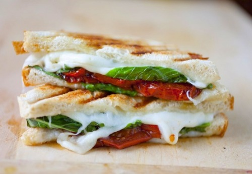 healthymissfit:  heyfranhey:   prettybalanced:  Mozzarella, Tomato and Basil Sandwich   Heaven on earth. Try this with spelt or ezekial bread!  i'm eating at panera tonight, FUCK DA BULLSHITTT