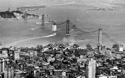 engineering-marvels:   Aerial view of the San Francisco Oakland Bay Bridge under construction in 1935. [source]