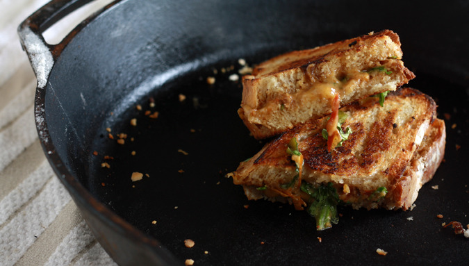 gastrogirl:  grilled cheese sandwich with tomato-onion jam and arugula.