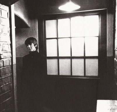 "thateventuality:  Scan - George on the set of ""A Hard Day's Night"" (scanned from The Beatles Anthology) ""George himself is no mystery. But the mystery inside George is immense. It's watching him uncover it all little by little that's so damn interesting."" - John Lennon"