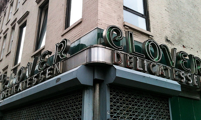Clover Delicatessen(in Kips Bay, formerly SoPo, on 2nd Avenue at 34th Street) Power is back on for most of Manhattan, but big sections of Brooklyn, Queens, and Staten Island are still dark, not to mention Westchester County, Long Island, and New Jersey. As the effects of Sandy stretch on, and as the nights get colder, this is going to cause more and more hardship. And so much cleaning and taking stock remains to be done. My health is still crap at the moment (plus there are still no working subways near me), so I can't get out to help Red Hook, Dumbo, Coney Island, Staten Island, Breezy Point, the Rockaways, or any of the other hardest-hit neighborhoods, but I'll be giving a couple of small donations (I wish I could afford more) to help those whose lives have been knocked sideways by the storm. If you'd like to help but aren't able to volunteer, here are a few suggestions: The Mayor's Fund Citymeals-on-Wheels Red Hook Initiative Red Cross Alliance for NYC Animals …and there are loads of other places. Feel free to put suggestions in the comments. The storm didn't affect me in any major way — the worst of it is that the lack of subways here has made it tough for me to get around. Getting into work on Thursday & Friday was a challenge, and that probably won't change for the next week. Really, though, I am very lucky — I'm unhurt, my apartment is fine, my electricity and gas haven't gone out (heat's been barely working, but that's nothing to do with the storm), even the internet has been up and running throughout. Coming home from work on Thursday, I walked about an hour south into the neighborhood jokingly referred to as SoPo (SOuth of POwer) — and nearly got stuck there when the line for the East River ferry ballooned to hundreds more people than the ferries could carry. On the way down, though, it was heartening to see so many signs of civility in the battered neighborhoods still without power at that point. Clover Deli, for one, was serving hot chocolate and coffee (though they rolled down the gates just before I took this picture since the sun was setting). Other businesses kept operating by candlelight. Street lights were out, and while traffic police had been dispatched to the largest intersections and traffic was relatively light, it was amazing to see and experience how well cars, bicycles, and pedestrians could negotiate the other intersections just by being civil. The rhythm of the city pulses on and New Yorkers find a way. It really is the MacGuyver of cities — we will take stock of what we have and what what needs to be done, and somehow we will connect the dots. Uptown near my work seeing some of the first neon signs I photographed for this project still alight, undamaged, was really heartening. Yes, it was the lucky NoPo neighborhood, but just to see that some things were still aglow even though half the skyline was dark, gave me hope. My heart goes out to everyone still suffering, and to those who have lost family or friends. I hope this disaster motivates us to put things right and rebuild better and brighter everything that was destroyed.