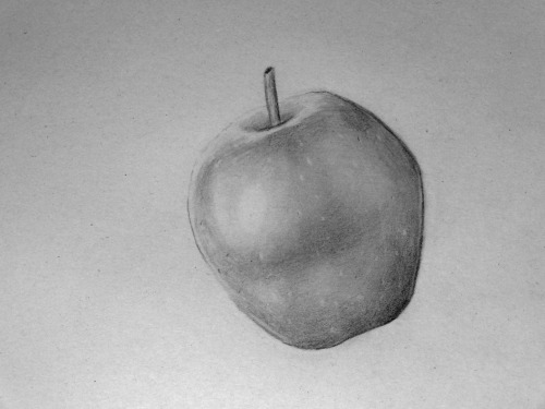 "TEASER! Well, hello again. This is an apple. The first part on my new project ""Color: RED,"" where I will try drawing the color red in graphite. A little experiment. The idea is, that I will draw things which I connect with the color red - for example the apple up above. The drawings will probably not be purely realistic. I have a lot of ideas in my head at the moment - one example is to draw a charizard too - but I have nothing settled yet, and old ideas can be trashed for new ones as I go. I will draw all the ""red"" elements on one drawing, in a mashup not unlike some of my other recent drawings. I hope the drawing will not be too long under construction - and that you will enjoy the product when it is done. I am not recording a speed-drawing video this time. •Simon"