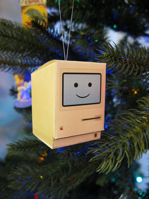 heyoscarwilde:  Think different. Happy Mac papercraft Christmas ornament available at blog.neoteny.com :: photograph by Chris De Jabet  Clever!
