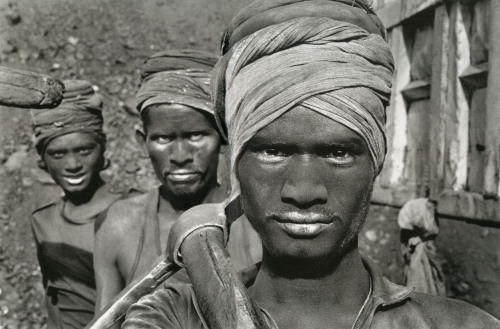 © Sebastião Salgado, 1989, Coal Mining, Dhanbad, Bihar, India Economist-turned-artist Sebastião Salgado began his photography practice after his finance role with the International Coffee Organization and the World Bank led him to travel to tea plantations in Africa. Inspired by the people he photographed during his trips, Salgado quit his finance job to continue traveling and photographing the rest of the world and its inhabitants. His works highlight global issues relating to nature, workers, and the human condition, and while he believes that his photographs alone will not be able to change the world, he can use them as a vehicle for awareness coupled with larger movements for action. (read more)