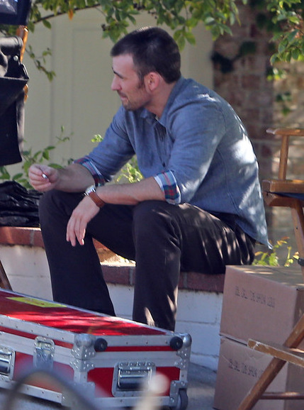 chrisevanshasmyheart:  hollywoodbulletin:  Chris Evans lights a cigarette while filming scenes for his next project A Many Splintered  Thing on Saturday (November 3) in Los Angeles.  Really liking the wardrobe so far.