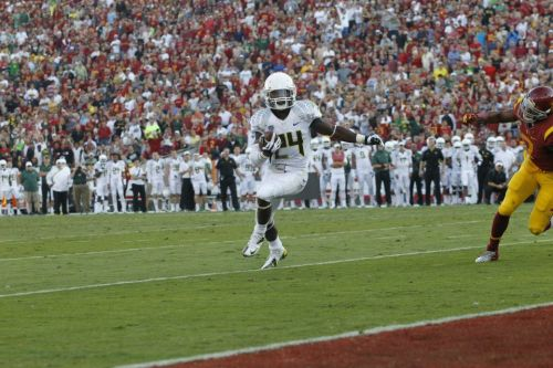 Oregon Football: Kenjon Barner Legitimizes a Heisman Campaign Kenjon Barner: 38 carries, 321 yards, 8.4 YPC, 5 TD's. Nothing spells greatness like his performance tonight. Congratulations to @KBDeuce4 for an incredible achievement and an impressive victory for the University of Oregon. Kenjon set the record for most Oregon rushing yards in a game, and helped Oregon score the most points USC has EVER allowed.  Help us keep his name trending on Twitter by RTing this post to keep #KB4NYC known around the world.  #StormLA #GoDucks