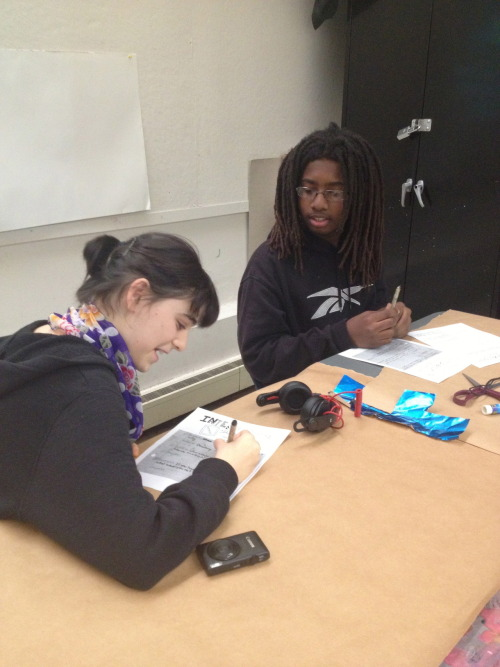 Week 3: Students interviewing one another to prep for self-portrait projects.
