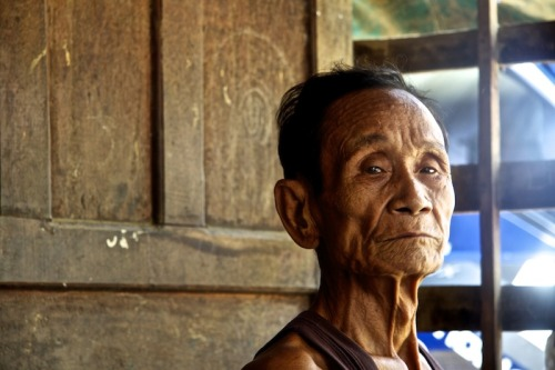 A Grandpa sits with pride, Laos