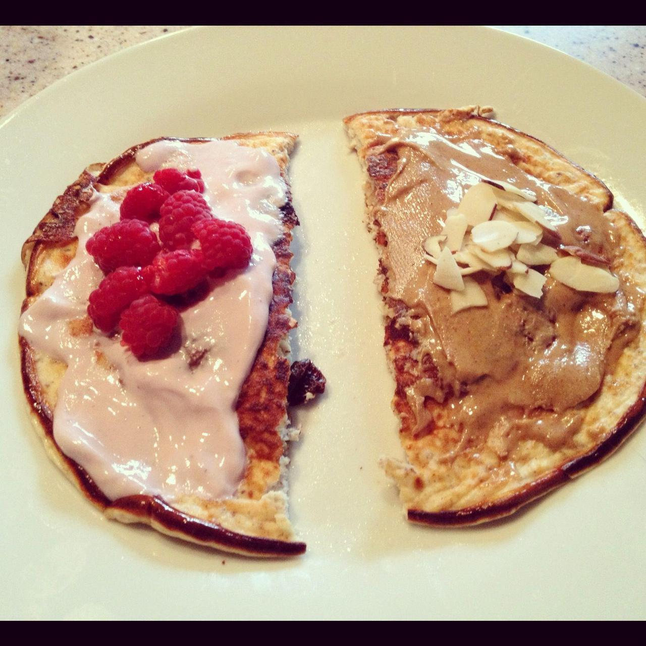 asliceofthefitlife:  Protein Pancake Brunch!!  These are as easy as cake! (PAN-cake!)  1/4 cup of oats 1/4 cup of fat free plain greek yogurt 1/2 scoop of vanilla protein powder (or any flavor you choose) 3 egg whites 1 tsp of almond extract (or vanilla) 1/2 tsp of cinnamon Whisk together all ingredients and pour in a nonstick skillet on medium heat. Once it bubbles on top flip over and cook for an additional 2-5 minutes. Serve with toppings of your choice — as you can tell I am indecisive on this so I go halfsies :) Greek yogurt and fresh fruit and/or nut butter and sliced almonds! HAPPY and RESTFUL SUNDAY KIDS!