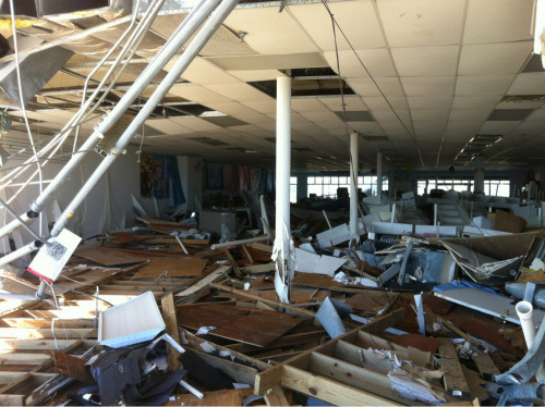 Looking west. One of the retail shops hit by the storm.