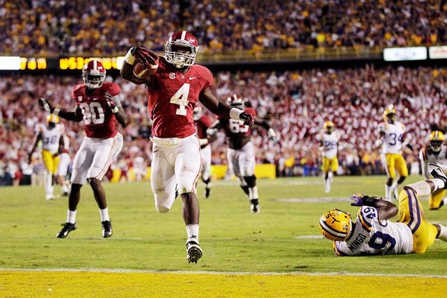 Alabama may have delivered a win — and a drive — for the ages. Down 17-14 with fewer than two minutes remaining, 'Bama gained possession on its own 28-yard line following a missed Drew Alleman field goal. AJ McCarron, who appeared rattled for most of the second half, completed three consecutive passes to junior wideout Kevin Norwood. Then the Tide completed the comeback: McCarron hooked up with freshman back T.J. Yeldon (pictured), who deked a defender and raced 28 yards to the end zone. Nick Saban's squad improved to 9-0, while LSU's Zach Mettenberger silenced many critics in defeat. He completed 24-of-35 passes for 298 yards and a touchdown. (AP) GALLERY: College Football Top 25 Review
