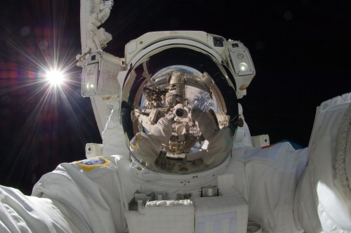 Orbiting Astronaut Self-Portrait Is it art? In September, space station astronaut Aki Hoshide (Japan) recorded this striking image while helping to augment the capabilities of the Earth-orbiting International Space Station (ISS). Visible in this outworldly assemblage is the Sun, the Earth, two portions of a robotic arm, an astronaut's spacesuit, the deep darkness of space, and the unusual camera taking the picture. This image joins other historic — and possibly artistic — self-portraits taken previously in space. The Expedition 32 mission ended on Sept. 17th when anattached capsule undocked with the ISS and returned some of the crew to Earth. Here, the second image - this time, with the visor up: http://spaceflight.nasa.gov/gallery/images/station/crew-32/hires/iss032e025256.jpg Image Credit: Expedition 32 Crew, International Space Station, NASA
